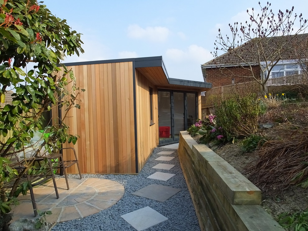 Edens Garden for Contemporary Shed with Sloping Garden