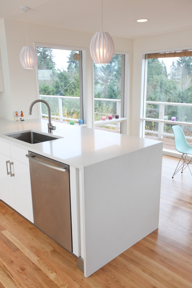 How to Clean Quartz Countertops for Midcentury Kitchen with Pendant Lighting