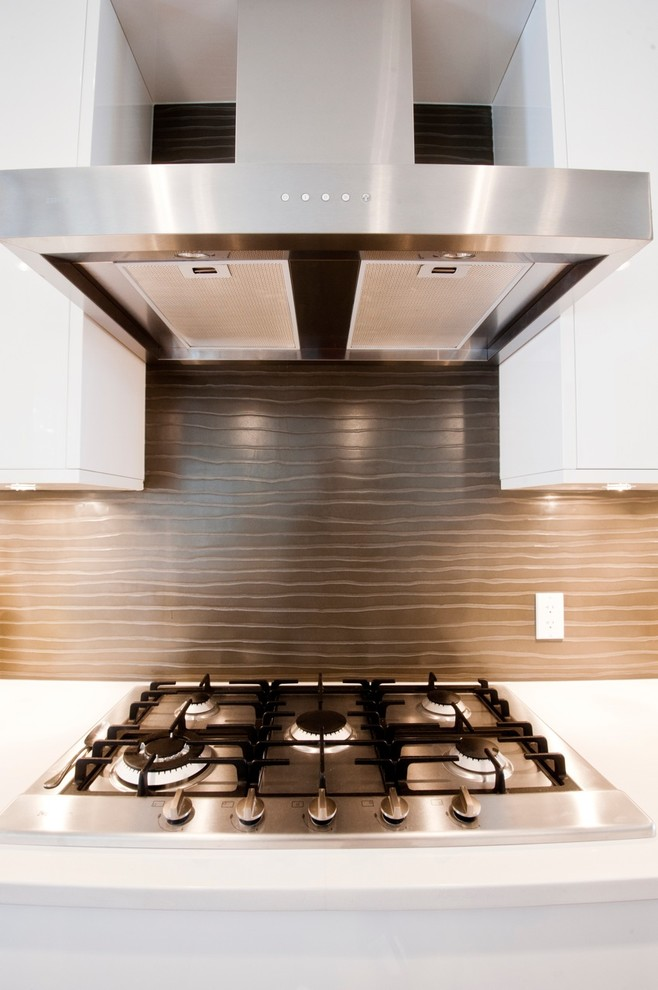 Installing Backsplash for Contemporary Kitchen with White Countertop