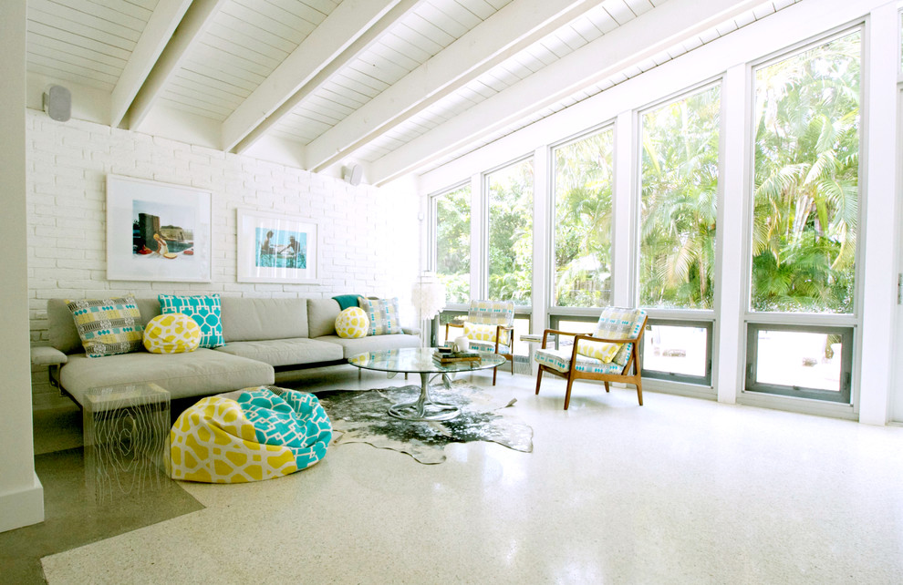Jalousies for Beach Style Living Room with White Painted Brick
