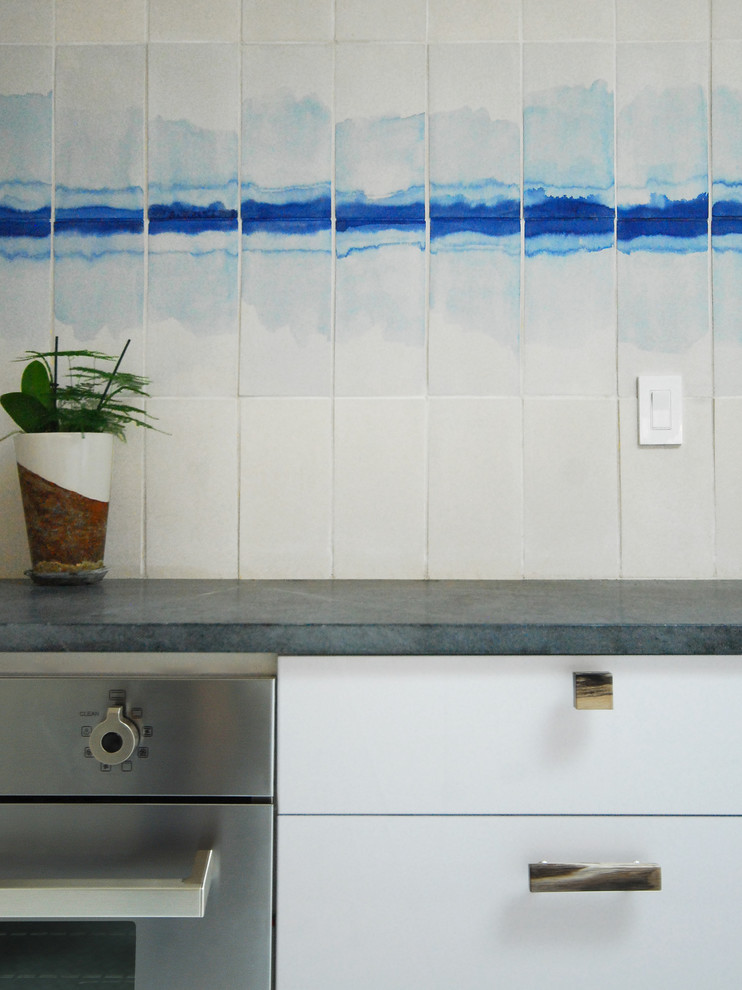 Jamieson Fence for Midcentury Kitchen with Petrified Wood Cabinet Pulls