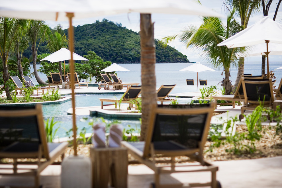 Likuliku Lagoon Resort Fiji for Tropical Spaces with Umbrellas