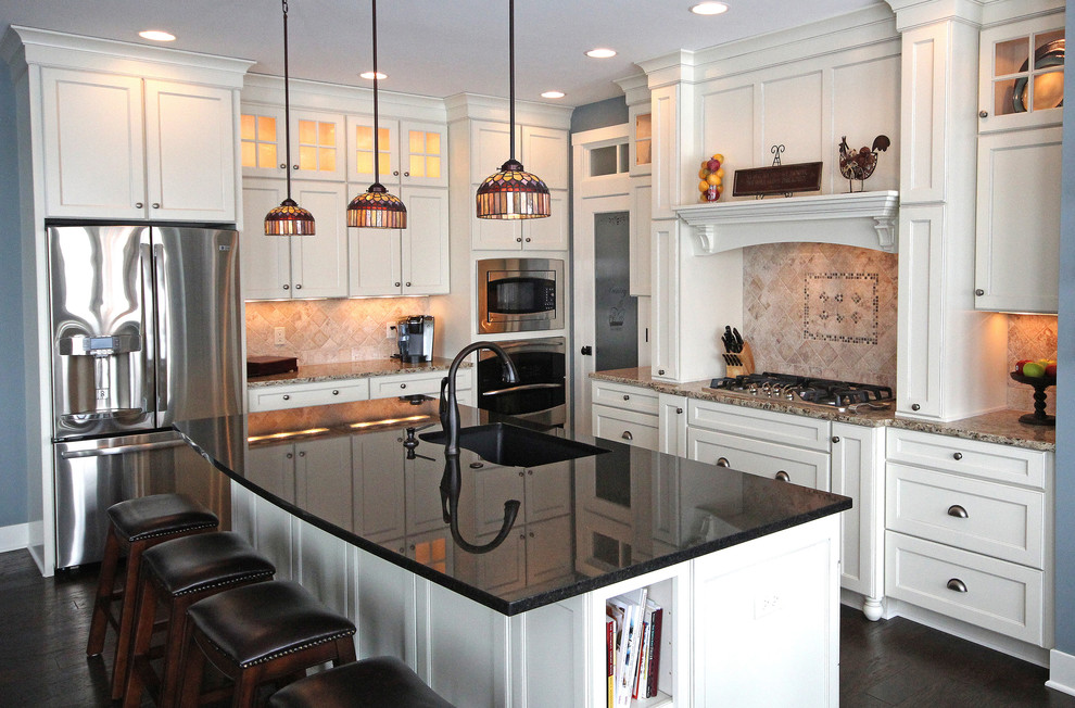 Midcontinent Cabinetry for Eclectic Kitchen with Hardwood Floor