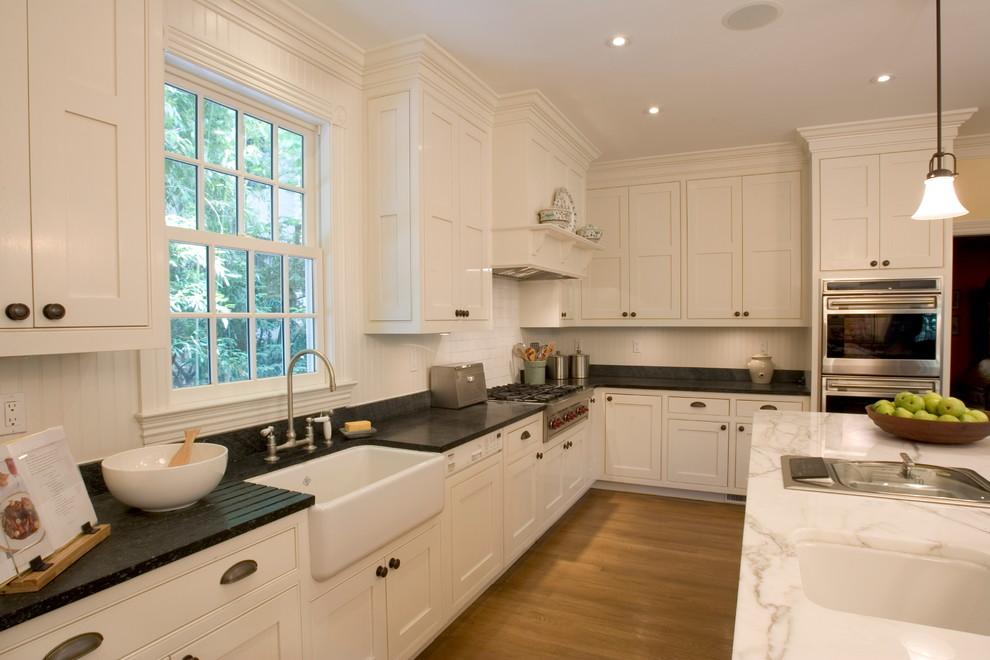 Soapstone vs Granite for Traditional Kitchen with Pendant Light