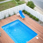 Ashley Furniture Wilmington Nc for Traditional Pool with White Fence