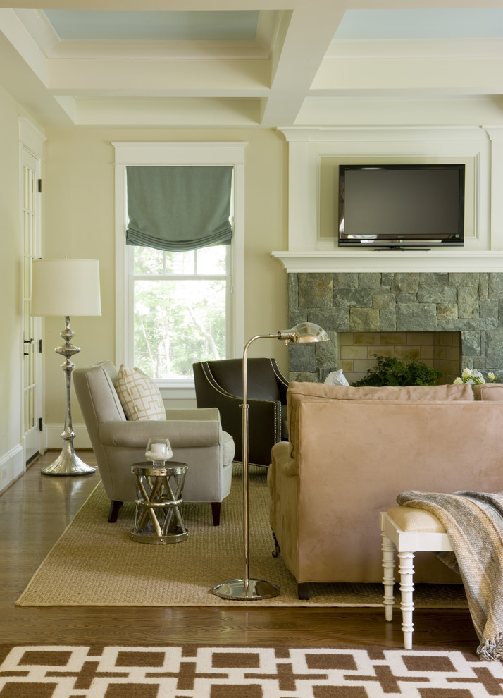 Benjamin Moore Manchester Tan for Contemporary Family Room with Dark Brown Armchair