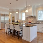 Benjamin Moore Muslin for Traditional Kitchen with Wolf Gas Range