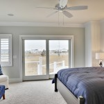 Benjamin Moore Sea Salt for Beach Style Bedroom with Wall Art