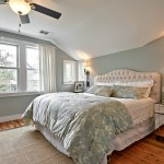 Benjamin Moore Tranquility for Transitional Bedroom with Tufted Headboard