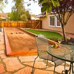 Bocce Ball Court for Eclectic Landscape with Stucco
