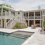 Brickman Landscaping for Beach Style Exterior with White Siding