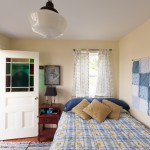 Bunkie for Beach Style Bedroom with Quilt