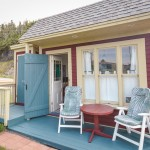 Bunkie for Beach Style Exterior with Blue Door