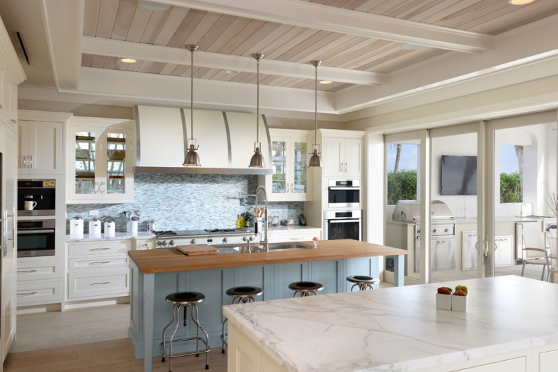 Candlelight Cabinetry for Beach Style Kitchen with Hood