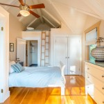 Cassies Closet for Beach Style Bedroom with Vaulted Ceiling
