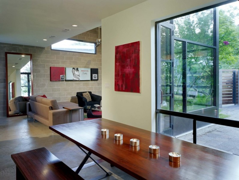 Cinder Block Retaining Wall for Industrial Dining Room with Open Floor Plan