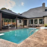 Cobblestone Homes for Traditional Pool with French Country