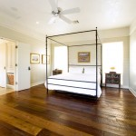 Cost to Refinish Hardwood Floors for Rustic Bedroom with Baseboards
