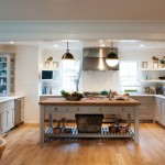 Crown Point Cabinetry for Farmhouse Kitchen with Lighting