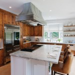 Crown Point Cabinetry for Rustic Kitchen with Oil Rubbed Bronze