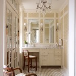 Designers Denn for Traditional Powder Room with Mosaic Tile Floors
