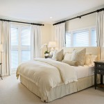 Difference Between Duvet and Comforter for Beach Style Bedroom with White Drapes