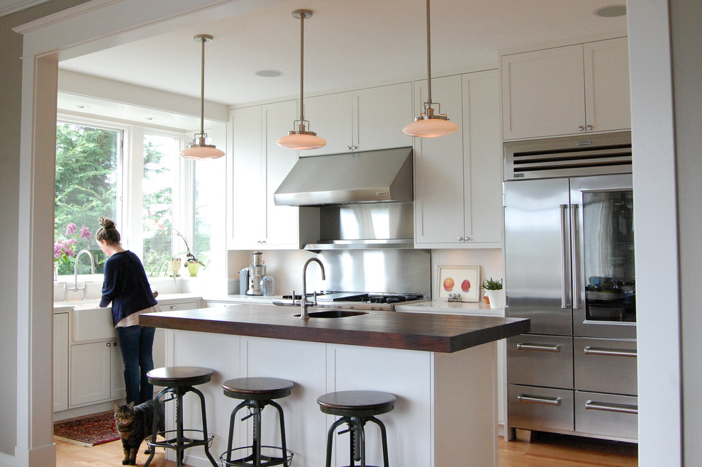Different Types of Countertops for Traditional Kitchen with Stainless Refrigerator