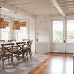 Dovetail Furniture for Beach Style Dining Room with Exposed Beams