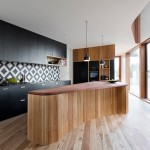 Engineered Hardwood vs Laminate for Contemporary Kitchen with Timber Bench