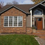 Environmental Stoneworks for Traditional Exterior with Board and Batten
