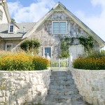 Environmental Stoneworks for Traditional Exterior with Picket Fence