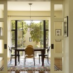 Feather River Doors for Transitional Dining Room with Wood Flooring