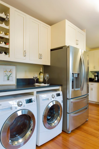 Gas Dryer vs Electric Dryer for Beach Style Kitchen with Black Counter