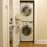Gas Dryer vs Electric for Contemporary Laundry Room with Stackable Washer and Dryer
