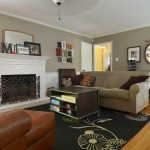 Greige Paint for Traditional Family Room with Hearth