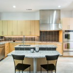 H2 Real Estate for Midcentury Kitchen with Metallic Tile