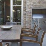 Hefner Furniture for Contemporary Patio with Stone Wall