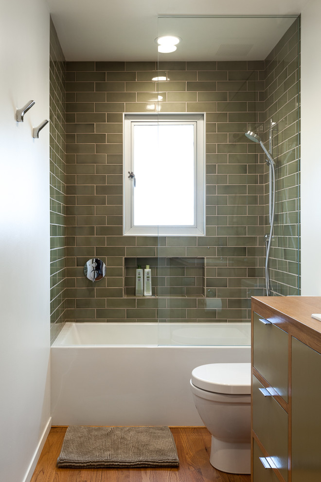 Hydrosystems for Midcentury Bathroom with Green Cabinets