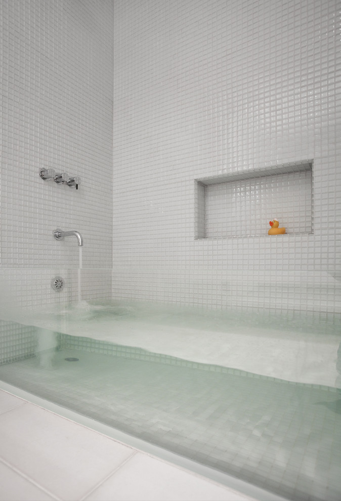 Installing a Bathtub for Contemporary Bathroom with White Tile