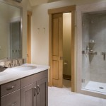 Installing Pocket Doors for Contemporary Bathroom with Sconce