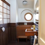 Japanica for Eclectic Bathroom with Circular Window