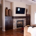 Jordahl Custom Homes for Traditional Spaces with Built in Cabinets Around Fireplace