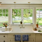 Kitchen Sink Lyrics for Traditional Kitchen with Yellow Cabinets