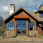 Loewen Windows for Traditional Exterior with Stone