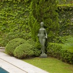 Malouf Furniture for Traditional Landscape with Stone Pool Trim