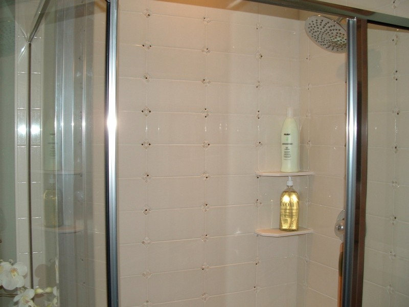 Marrano Homes for Traditional Bathroom with Ceramic Tile Shower Surround in a Marran