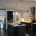 Mid Continent Cabinetry for Contemporary Kitchen with Dark Floor