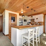 Niblock Homes for Rustic Kitchen with Carpet