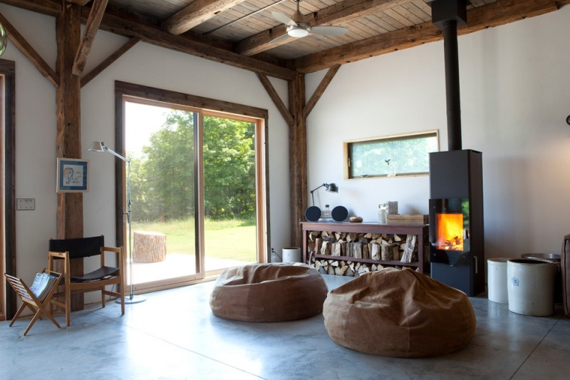 Pacific Energy Wood Stove for Rustic Living Room with Exposed Beams
