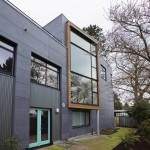 Painting Vinyl Siding for Industrial Exterior with Picture Windows